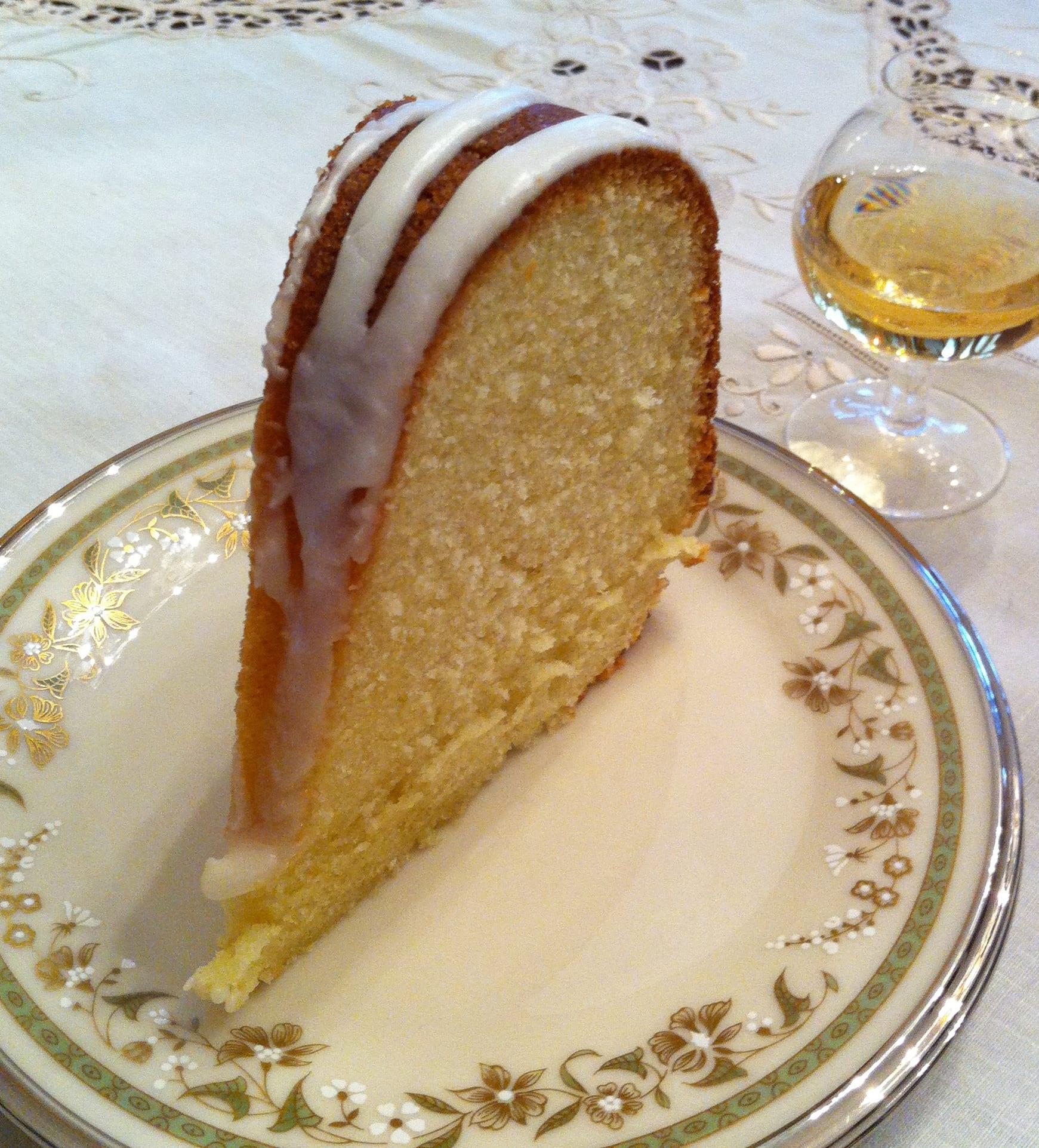 Slice of pound cake with brandy snifer