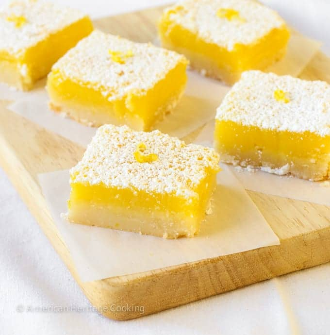 These easy lemon bars have a thick shortbread crust and a sweet tart lemon filling! They really are a burst of sunshine!
