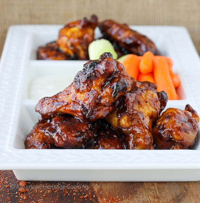 https://americanheritagecooking.com/wp-content/uploads/2014/10/Saucy-Chipotle-Maple-Baked-Chicken-Wings-1410123509.jpg