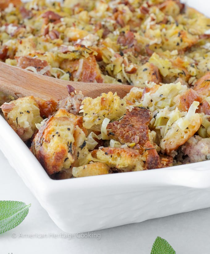 This easy Apple Sage Sausage Stuffing recipe will be a sure hit! The leeks, fresh herbs, apples, and spicy Italian sausage make it incredibly flavorful!