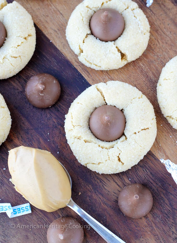 Peanut Butter Blossoms are a classic chewy peanut butter cookie rolled in sugar and topped with a Hershey kiss. A little crisp outside but chewy within!