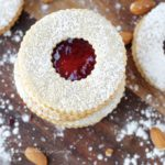 A recipe for the classic Austrian Raspberry Linzer Cookies   A delightful rolled almond cookie filled with raspberry preserves and dusted with powdered sugar! A new Christmas favorite!