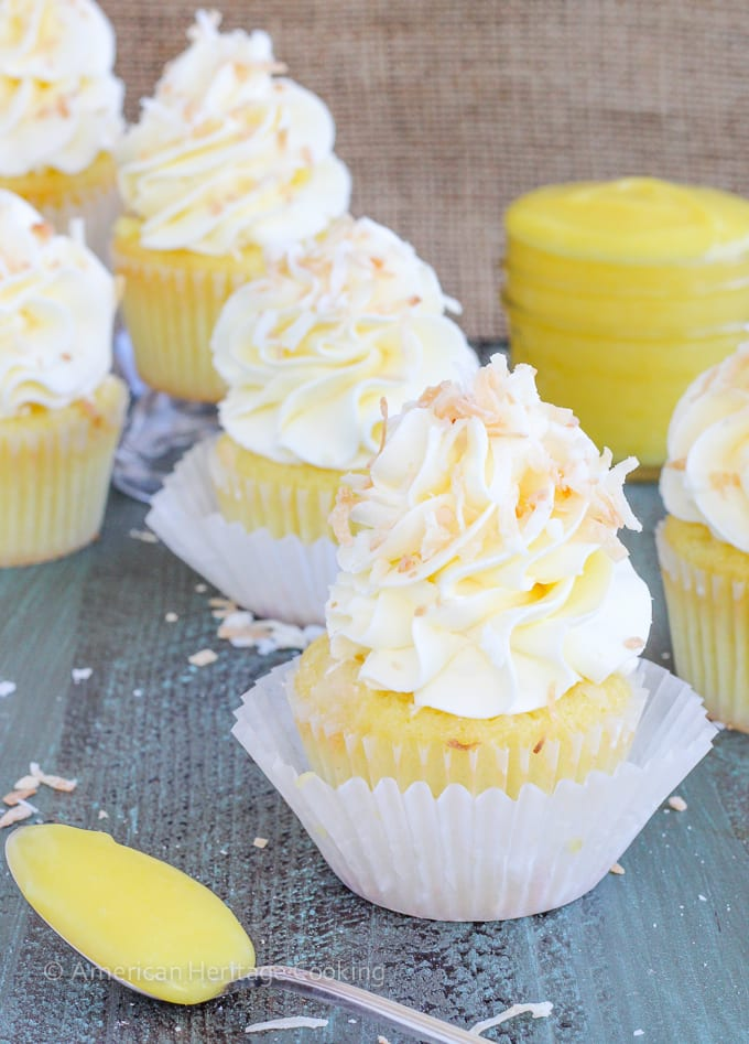 These Lemon Coconut Cupcakes have a moist coconut cake, a sweet, tart lemon curd filling and are topped with a lemon Italian meringue buttercream!