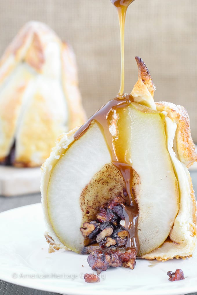 These Brown Sugar Pecan Stuffed Pears are d'Anjou pears stuffed with a simple mixture of brown sugar, cinnamon, cardamom and toasted pecans are wrapped in a flakey pastry, sprinkled with more sugar and topped with a warm butterscotch sauce.