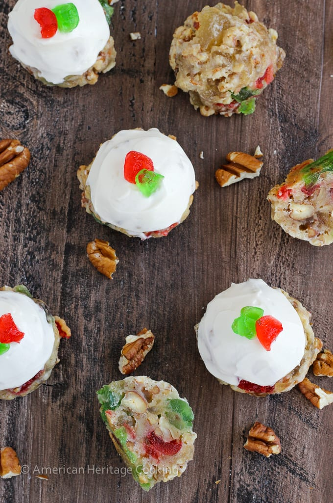 Fruitcake Cookies are chewy sugar cookies stuffed full of candied fruits, raisins and toasted pecans for a unique twist on the classic Christmas fruitcake! Topped with a brandy cream cheese frosting, these little cookies are irresistible!