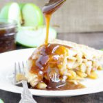 This Butterscotch Apple Pie is absolute heaven! Lightly spiced apples baked inside a flakey all-butter crust with brown sugar butterscotch sauce!