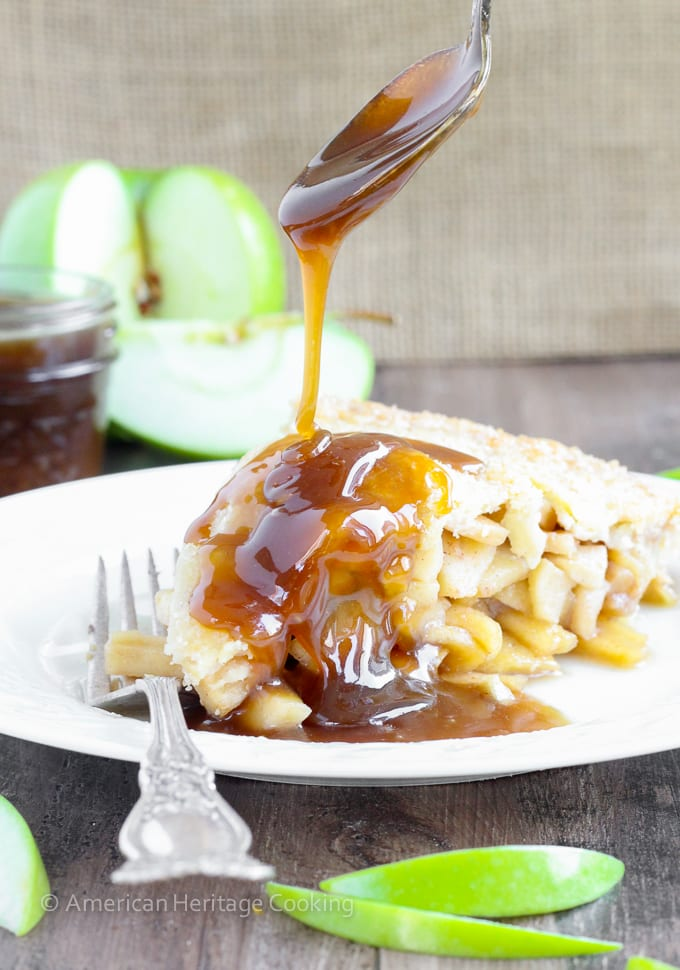 This Apple Butterscotch Pie is absolute heaven! Lightly spiced apples baked inside a flakey all-butter crust with brown sugar butterscotch sauce!