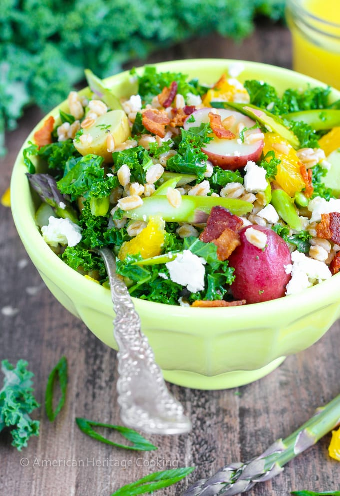 In this Asparagus Orange Farro Salad boiled new potatoes, crispy raw asparagus, chewy farro, peppery scallions, salty feta and crispy bacon all get tossed in a bright orange vinaigrette for a mouthful of Spring flavors!