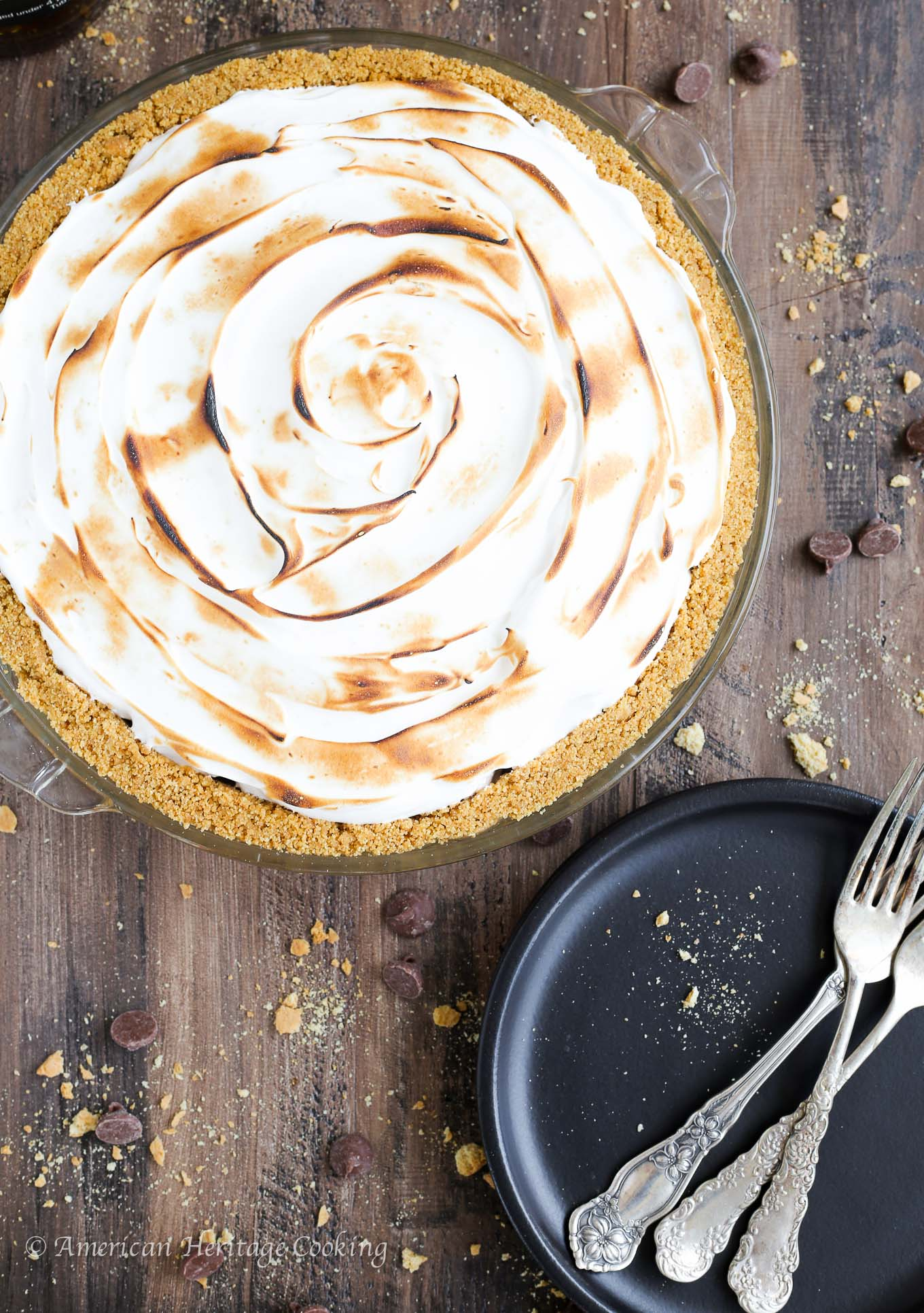 This No Bake Whiskey Smores Pie is a slice of Summer Heaven! There are layers of dark chocolate whisky ganache, milk chocolate mousse and fluffy toasted marshmallow in the perfect graham cracker crust. Go ahead…help yourself to another slice.