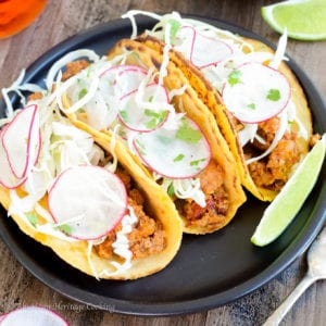 These Chipotle Chorizo Tacos are smoky, spicy and complex! The homemade sweet potato tortilla temper the spice with a little bit of sweetness and a mezcal lime slaw brightens the flavors and pulls the whole taco together!