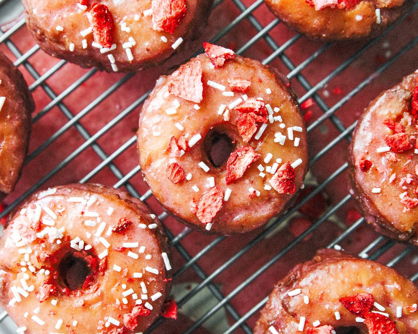 These fried Strawberry Lemon Cake Donuts have a soft, tender lemon almond cake absolutely coated in a strawberry glaze made with a quick homemade strawberry jam! And easier than you think!
