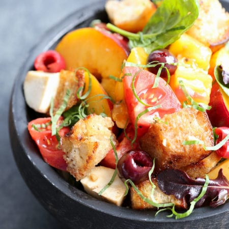 There is nothing better than taking all of Summer's bounty and throwing it into an easy, no-oven salad! This Stonefruit Caprese Panzanella Salad is at once familiar and comforting with a hint of the unexpected!