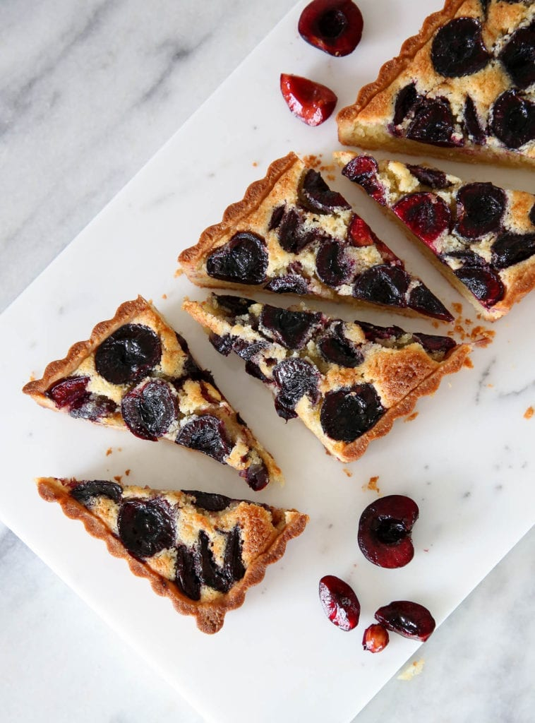 This Cherry Almond Tart is easy and delicious! The almond sablée crust is crunchy and tender, the almond cream filling is soft, and the fresh cherries are baked to jammy perfection!