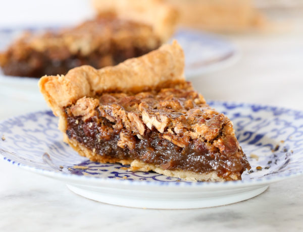 This Bourbon Pecan Pie is creamy, rich and nutty! My vodka all butter pie crust adds the perfect flaky, buttery base for the pecan pie of your dreams!