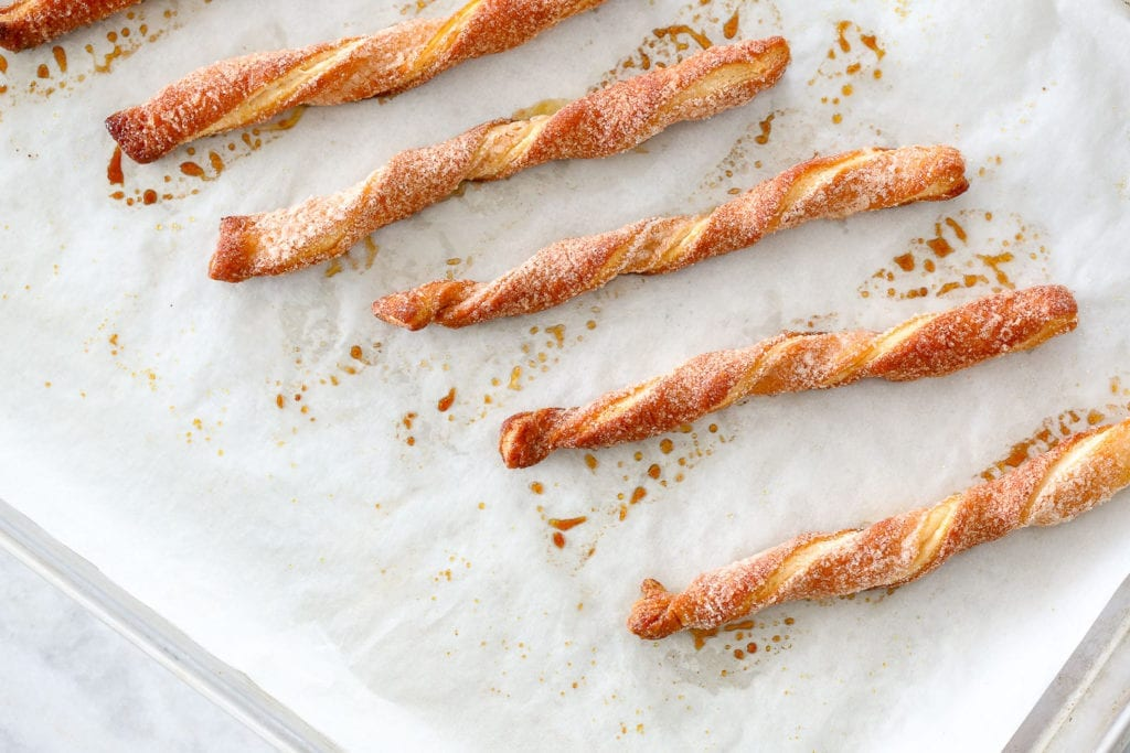Cinnamon Sugar Twists are an easy dessert you can make with puff pastry scraps! Only three ingredients and you have a delicious dessert!