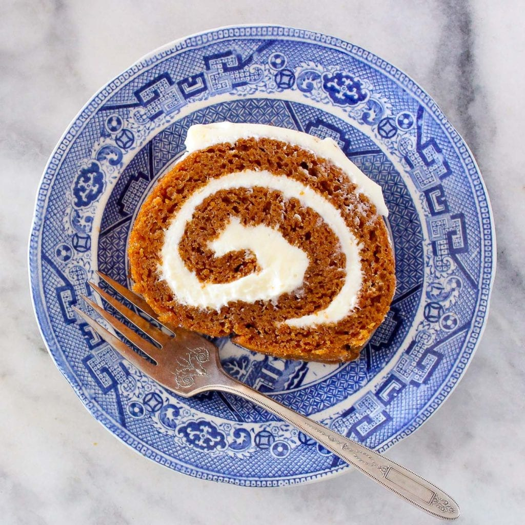 This spiced Pumpkin Roll is easier to make than you think! It is a soft, moist pumpkin cake is rolled around an easy cream cheese frosting!
