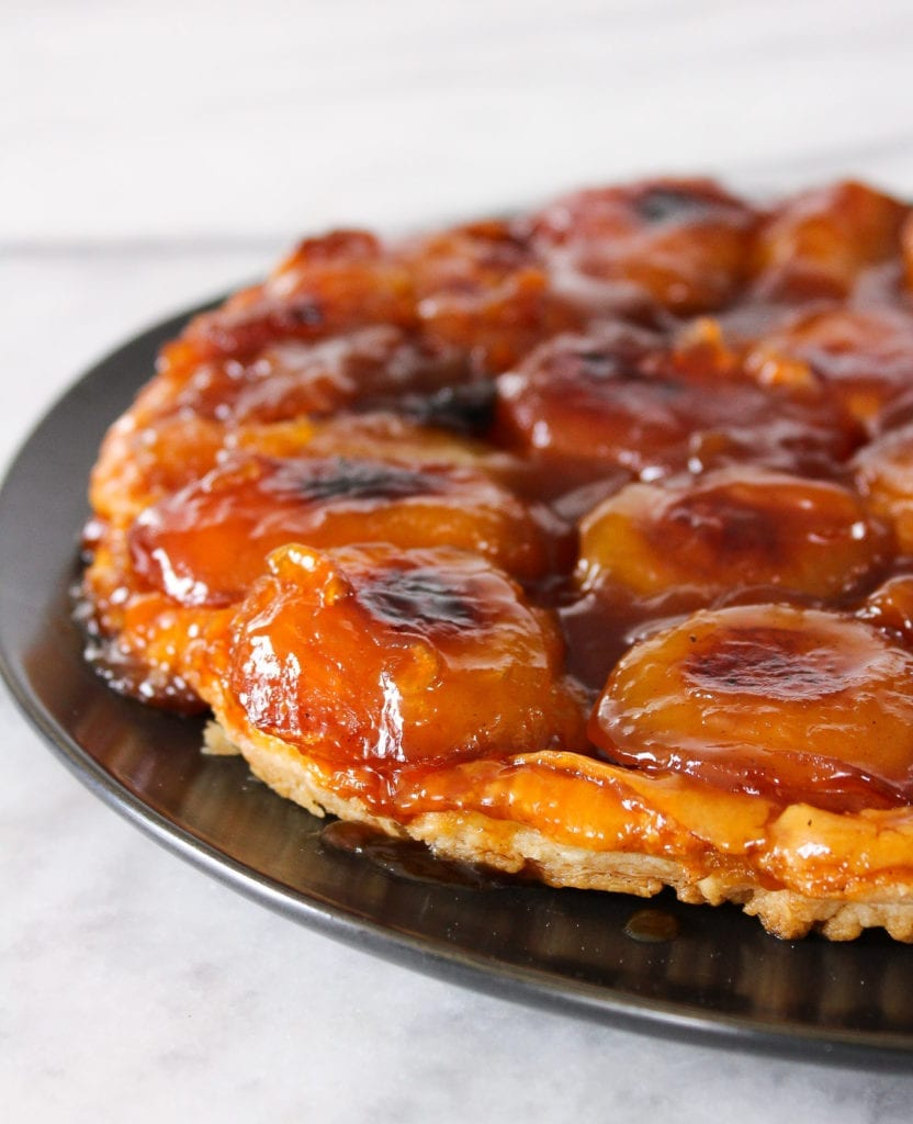 This Apple Tarte Tatin is what Francophile dreams are made of! It has buttery puff pastry cooked to perfection, deep caramelized apples, and is flambéed just because!